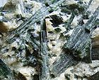 Actinolite crystal in matrix from Finland that is treated as asbestos 001.jpg