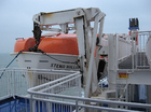 Davits on the Starboard of North Sea Ferry Holding a Lifeboat 001.png