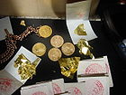 Gold coins and gold leaf 001.jpg