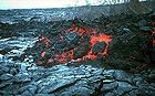 Rocky A a lava flow front advances over smooth billowy surface of pahoehoe.jpg