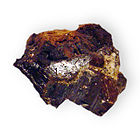 Alabandite or alabandine is a mineral with the chemical formula Mn2+S. It has cubic crystals.jpg